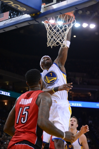 December 3, 2013; Oakland, CA, USA; Golden State Warriors center Jermaine O'Neal (7) dunks the basketball against Toronto Raptors power forward Amir Johnson (15) during the fourth quarter at Oracle Arena. The Warriors defeated the Raptors 112-103. Mandatory Credit: Kyle Terada-USA TODAY Sports