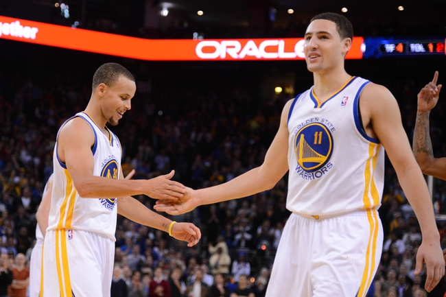 December 3, 2013; Oakland, CA, USA; Golden State Warriors point guard Stephen Curry (30, left) and shooting guard Klay Thompson (11) celebrate during the fourth quarter against the Toronto Raptors at Oracle Arena. The Warriors defeated the Raptors 112-103. Mandatory Credit: Kyle Terada-USA TODAY Sports