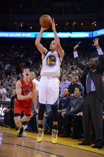 December 3, 2013; Oakland, CA, USA; Golden State Warriors point guard Stephen Curry (30) makes a three-point basket against Toronto Raptors power forward Tyler Hansbrough (50) and head coach Dwane Casey (right) during the fourth quarter at Oracle Arena. The Warriors defeated the Raptors 112-103. Mandatory Credit: Kyle Terada-USA TODAY Sports