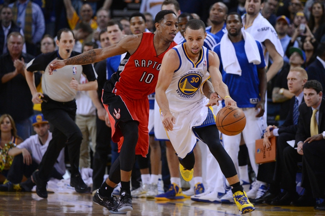 December 3, 2013; Oakland, CA, USA; Golden State Warriors point guard Stephen Curry (30) is fouled by Toronto Raptors shooting guard DeMar DeRozan (10) during the fourth quarter at Oracle Arena. The Warriors defeated the Raptors 112-103. Mandatory Credit: Kyle Terada-USA TODAY Sports