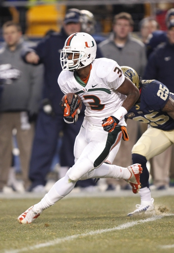 Nov 29, 2013; Pittsburgh, PA, USA; Miami Hurricanes wide receiver Stacy Coley (3) carries the ball against the Pittsburgh Panthers during the second quarter at Heinz Field. Miami won 41-31. Mandatory Credit: Charles LeClaire-USA TODAY Sports