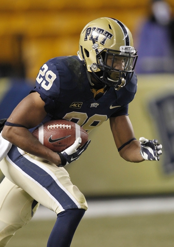 Nov 29, 2013; Pittsburgh, PA, USA; Pittsburgh Panthers running back Rachid Ibrahim (29) returns a kick-off against the Miami Hurricanes during the fourth quarter at Heinz Field. Miami won 41-31. Mandatory Credit: Charles LeClaire-USA TODAY Sports