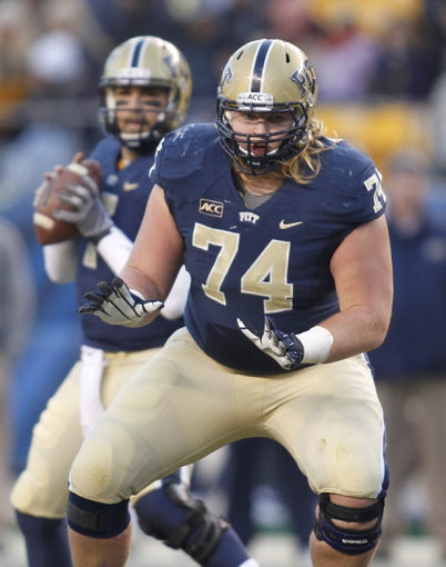 Nov 29, 2013; Pittsburgh, PA, USA; Pittsburgh Panthers offensive linesman Matt Rotheram (74) blocks at the line of scrimmage against the Miami Hurricanes during the second quarter at Heinz Field. Miami won 41-31. Mandatory Credit: Charles LeClaire-USA TODAY Sports