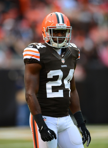 Dec 1, 2013; Cleveland, OH, USA; Cleveland Browns cornerback Johnson Bademosi (24) against the Jacksonville Jaguars at FirstEnergy Stadium. Mandatory Credit: Andrew Weber-USA TODAY Sports
