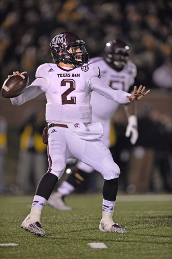 Nov 30, 2013; Columbia, MO, USA; Texas A&M Aggies quarterback Johnny Manziel (2) drops back to pass against the Missouri Tigers during the second half at Faurot Field. Mandatory Credit: Peter G. Aiken-USA TODAY Sports