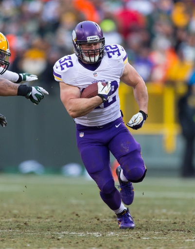 Nov 24, 2013; Green Bay, WI, USA; Minnesota Vikings running back Toby Gerhart (32) during the game against the Green Bay Packers at Lambeau Field.  The Vikings and Packers tied 26-26.  Mandatory Credit: Jeff Hanisch-USA TODAY Sports