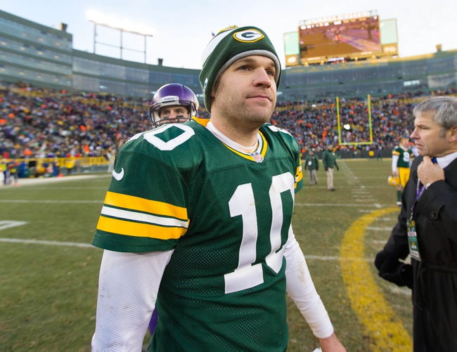 Nov 24, 2013; Green Bay, WI, USA; Green Bay Packers quarterback Matt Flynn (10) following the game against the Minnesota Vikings at Lambeau Field.  The Vikings and Packers tied 26-26.  Mandatory Credit: Jeff Hanisch-USA TODAY Sports