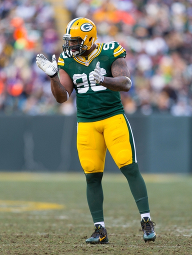 Nov 24, 2013; Green Bay, WI, USA; Green Bay Packers defensive end Mike Neal (96) during the game against the Minnesota Vikings at Lambeau Field.  The Vikings and Packers tied 26-26.  Mandatory Credit: Jeff Hanisch-USA TODAY Sports
