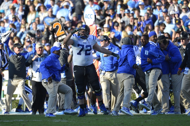 Nov 30, 2013; Chapel Hill, NC, USA; Duke Blue Devils offensive tackle Perry Simmons (72) reacts late in the fourth quarter. The Blue Devils defeated the Tar Heels 27-25 at Kenan Memorial Stadium. Mandatory Credit: Bob Donnan-USA TODAY Sports