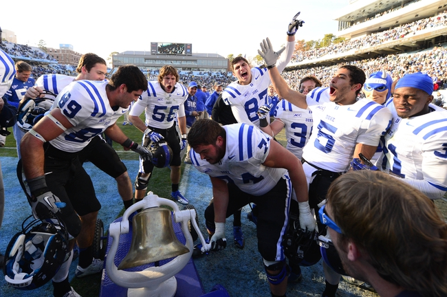 Nov 30, 2013; Chapel Hill, NC, USA;  Duke Blue Devils tight end Braxton Deaver (89) and linebacker Kyler Brown (56) and guard Dave Harding (74) and  wide receiver Max McCaffrey (87) and wide receiver Brandon Braxton (5) and safety Christian Conway (36) and cornerback Breon Borders (31) ring the victory bell after the game. The Blue Devils defeated the North Carolina Tar Heels 27-25 at Kenan Memorial Stadium. Mandatory Credit: Bob Donnan-USA TODAY Sports