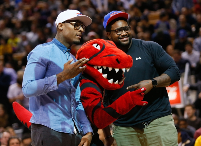 Nov 29, 2013; Toronto, Ontario, CAN; Buffalo Bills wide receiver Stevie Johnson (left) and defensive lineman Marcell Dareus (right) pose with the Toronto Raptors mascot Stripes during a game against the Miami Heat at the Air Canada Centre. Miami defeated Toronto 90-83. Mandatory Credit: John E. Sokolowski-USA TODAY Sports