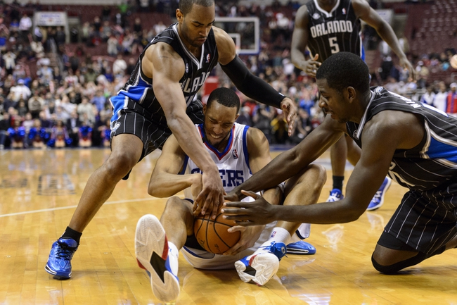 Dec 3, 2013; Philadelphia, PA, USA; Orlando Magic guard Arron Afflalo (4) and forward Andrew Nicholson (44) battle for a loose ball with Philadelphia 76ers guard Evan Turner (12) during overtime at the Wells Fargo Center. The Sixers defeated the Magic 126-125 in double overtime. Mandatory Credit: Howard Smith-USA TODAY Sports