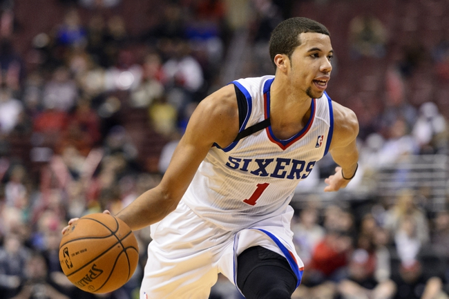 Dec 3, 2013; Philadelphia, PA, USA; Philadelphia 76ers guard Michael Carter-Williams (1) during overtime against the Orlando Magic at the Wells Fargo Center. The Sixers defeated the Magic 126-125 in double overtime. Mandatory Credit: Howard Smith-USA TODAY Sports