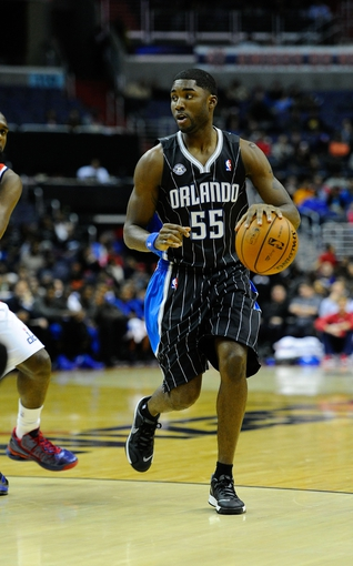 Dec 2, 2013; Washington, DC, USA; Orlando Magic point guard E'Twaun Moore (55) dribbles the ball against the Washington Wizards during the second half at the Verizon Center. The Wizards defeated the Magic 98 - 80. Mandatory Credit: Brad Mills-USA TODAY Sports