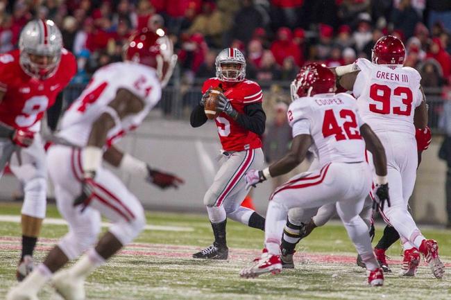 Nov 23, 2013; Columbus, OH, USA; Ohio State Buckeyes quarterback Braxton Miller (5) drops back to pass in the first quarter of the game against the Indiana Hoosiers at Ohio Stadium. Ohio State Buckeyes beat Indiana Hoosiers 42-14. Mandatory Credit: Trevor Ruszkowksi-USA TODAY Sports