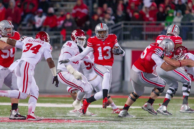 Nov 23, 2013; Columbus, OH, USA;  Ohio State Buckeyes quarterback Kenny Guiton (13) runs with the ball in the fourth quarter of the game against the Indiana Hoosiers at Ohio Stadium. Ohio State Buckeyes beat Indiana Hoosiers 42-14. Mandatory Credit: Trevor Ruszkowksi-USA TODAY Sports