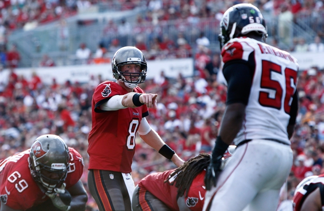 Nov 17, 2013; Tampa, FL, USA; Tampa Bay Buccaneers quarterback Mike Glennon (8) points against the Atlanta Falcons during the second half at Raymond James Stadium. Tampa Bay Buccaneers defeated the Atlanta Falcons 41-28. Mandatory Credit: Kim Klement-USA TODAY Sports