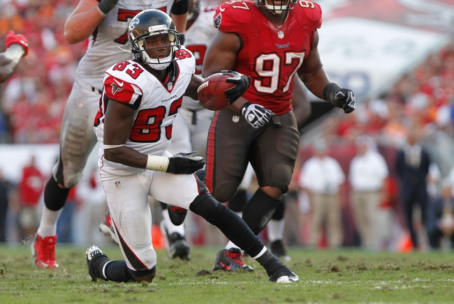 Nov 17, 2013; Tampa, FL, USA; Atlanta Falcons wide receiver Harry Douglas (83) runs with the ball against the Tampa Bay Buccaneers during the second half at Raymond James Stadium. Tampa Bay Buccaneers defeated the Atlanta Falcons 41-28. Mandatory Credit: Kim Klement-USA TODAY Sports