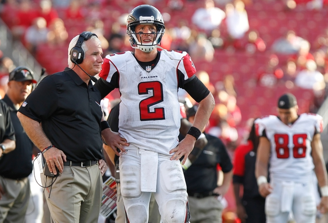 Nov 17, 2013; Tampa, FL, USA; Atlanta Falcons head coach Mike Smith talks with quarterback Matt Ryan (2) against the Tampa Bay Buccaneers during the second half at Raymond James Stadium. Tampa Bay Buccaneers defeated the Atlanta Falcons 41-28. Mandatory Credit: Kim Klement-USA TODAY Sports