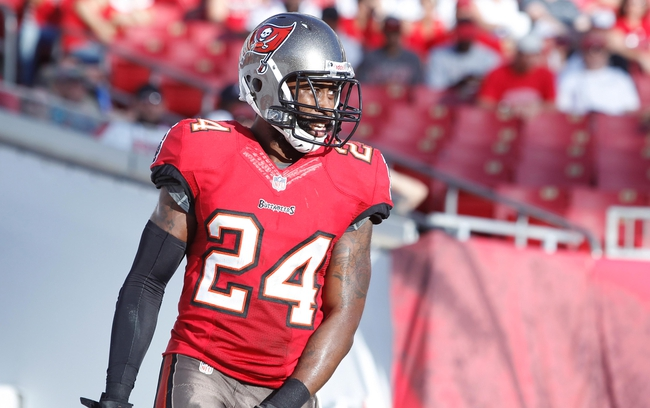 Nov 17, 2013; Tampa, FL, USA; Tampa Bay Buccaneers cornerback Darrelle Revis (24) against the Atlanta Falcons during the second half at Raymond James Stadium. Tampa Bay Buccaneers defeated the Atlanta Falcons 41-28. Mandatory Credit: Kim Klement-USA TODAY Sports