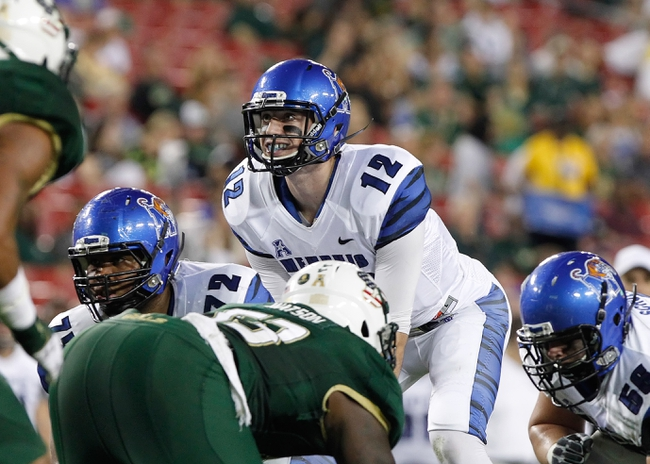 Nov 16, 2013; Tampa, FL, USA; Memphis Tigers quarterback Paxton Lynch (12) calls a play against the South Florida Bulls during the first quarter at Raymond James Stadium. Mandatory Credit: Kim Klement-USA TODAY Sports