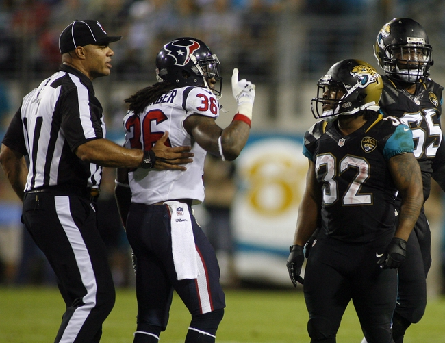 Dec 5, 2013; Jacksonville, FL, USA; Umpire Fred Bryan moves Houston Texans strong safety D.J. Swearinger (36) away from Jacksonville Jaguars running back Maurice Jones-Drew (32) before he was penalized for taunting in the second quarter at EverBank Field. Mandatory Credit: Phil Sears-USA TODAY Sports