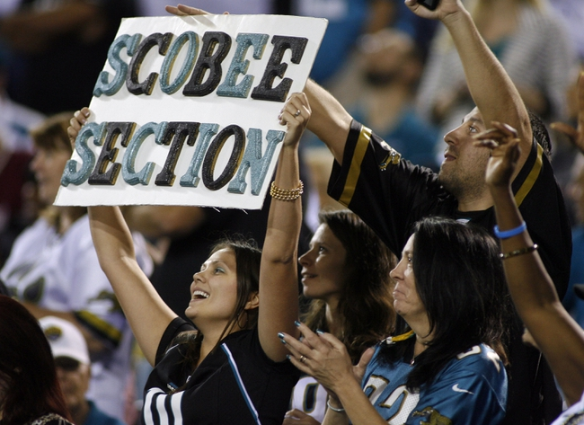 Dec 5, 2013; Jacksonville, FL, USA; Jacksonville Jaguars fans of kicker Josh Scobee (not pictured) hold up a sign after his field goal at the end of the second quarter against the Houston Texans at EverBank Field. Mandatory Credit: Phil Sears-USA TODAY Sports