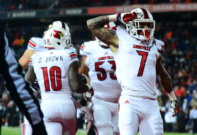 Dec 5, 2013; Cincinnati, OH, USA; Louisville Cardinals wide receiver Damian Copeland (7) celebrates after catching a pass in the end zone for a touchdown during the fourth quarter against the Cincinnati Bearcats at Nippert Stadium. Mandatory Credit: Andrew Weber-USA TODAY Sports