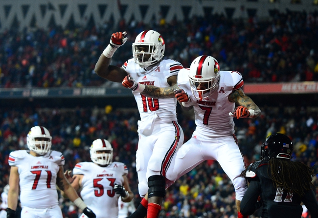 Dec 5, 2013; Cincinnati, OH, USA; Louisville Cardinals running back Dominique Brown (10)  wide receiver Damian Copeland (7) after catching a pass in the end zone for a touchdown during the fourth quarter against the Cincinnati Bearcats at Nippert Stadium. Mandatory Credit: Andrew Weber-USA TODAY Sports