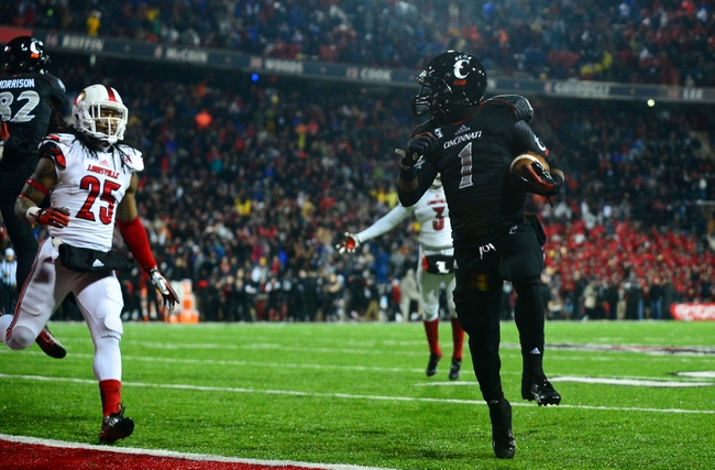 Dec 5, 2013; Cincinnati, OH, USA; Cincinnati Bearcats running back Ralph Abernathy (1) rushes into the end zone for a touchdown during the fourth quarter against the Louisville Cardinals at Nippert Stadium. Mandatory Credit: Andrew Weber-USA TODAY Sports