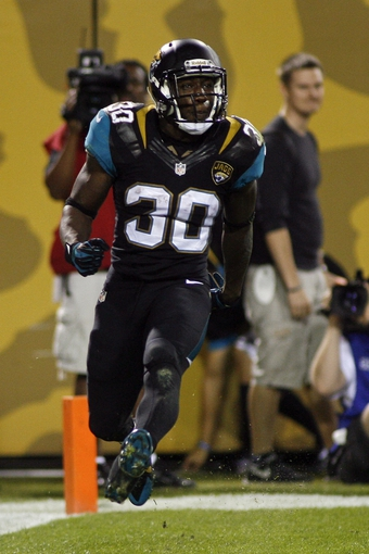 Dec 5, 2013; Jacksonville, FL, USA; Jacksonville Jaguars running back Jordan Todman (30) celebrates after catching a 21-yard touchdown pass thrown by wide receiver Ace Sanders (not pictured) in the third quarter against the Houston Texans at EverBank Field. Mandatory Credit: Phil Sears-USA TODAY Sports