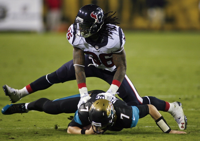 Dec 5, 2013; Jacksonville, FL, USA; Houston Texans strong safety D.J. Swearinger (36) takes down Jacksonville Jaguars quarterback Chad Henne (7) in the third quarter at EverBank Field. Mandatory Credit: Phil Sears-USA TODAY Sports