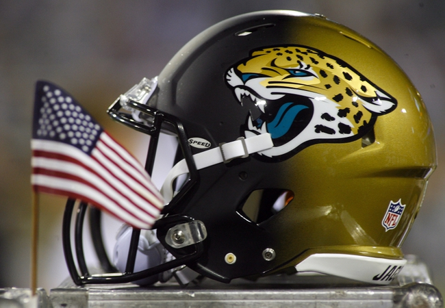 Dec 5, 2013; Jacksonville, FL, USA; A Jacksonville Jaguars helmet and an American flag in the third quarter of their game against the Houston Texans at EverBank Field. Mandatory Credit: Phil Sears-USA TODAY Sports