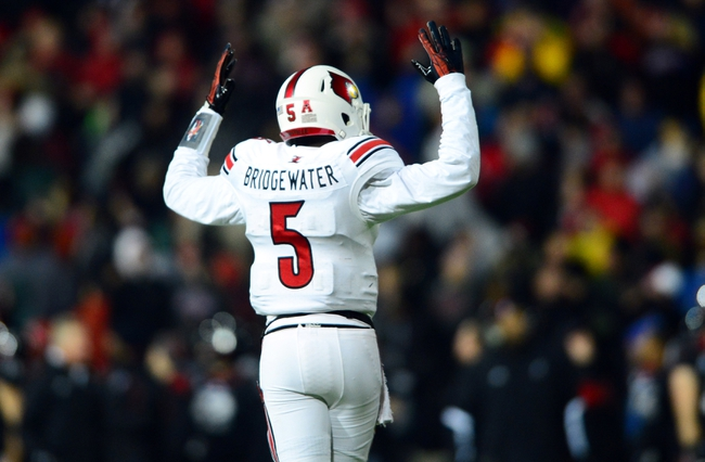 Dec 5, 2013; Cincinnati, OH, USA; Louisville Cardinals quarterback Teddy Bridgewater (5) reacts to a touchdown during the fourth quarter against the Cincinnati Bearcats at Nippert Stadium. Mandatory Credit: Andrew Weber-USA TODAY Sports