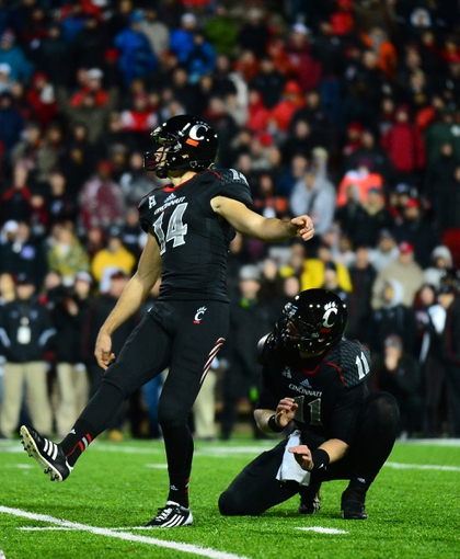 Dec 5, 2013; Cincinnati, OH, USA; Cincinnati Bearcats kicker Tony Miliano (14) kicks a field goal to send to game into overtime during the fourth quarter against the Louisville Cardinals at Nippert Stadium. Mandatory Credit: Andrew Weber-USA TODAY Sports