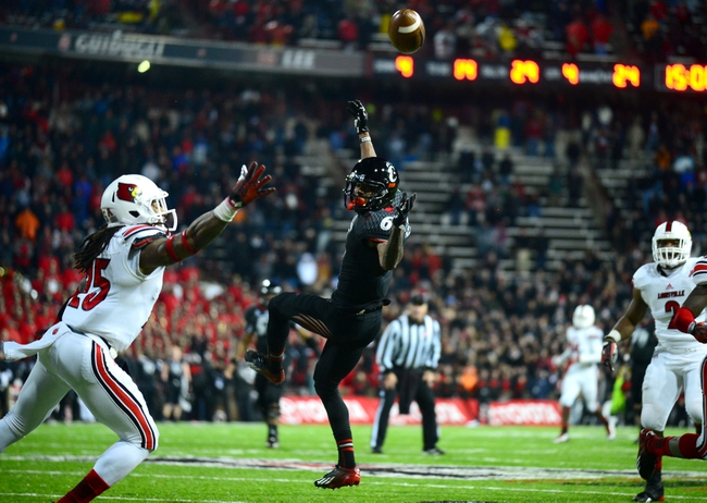 Dec 5, 2013; Cincinnati, OH, USA; A pass intended for Cincinnati Bearcats wide receiver Anthony McClung (6) falls incomplete in overtime giving the win to Louisville Cardinals 31-24 at Nippert Stadium. Mandatory Credit: Andrew Weber-USA TODAY Sports