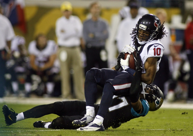Dec 5, 2013; Jacksonville, FL, USA; Houston Texans wide receiver DeAndre Hopkins (10) catches a pass for a first down as Jacksonville Jaguars cornerback Dwayne Gratz (27) takes him down in the fourth quarter at EverBank Field. The Jacksonville Jaguars best the Houston Texans 27-20. Mandatory Credit: Phil Sears-USA TODAY Sports
