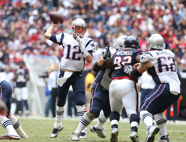 Dec 1, 2013; Houston, TX, USA; New England Patriots quarterback Tom Brady (12) throws in the pocket against the Houston Texans at Reliant Stadium. Mandatory Credit: Matthew Emmons-USA TODAY Sports