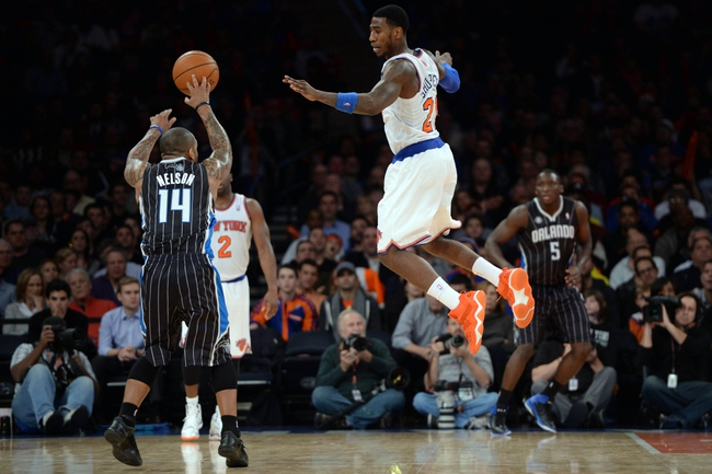 Dec 6, 2013; New York, NY, USA; New York Knicks shooting guard Iman Shumpert (21) guards Orlando Magic point guard Jameer Nelson (14) during the second half at Madison Square Garden. The Knicks won the game 121-83. Mandatory Credit: Joe Camporeale-USA TODAY Sports