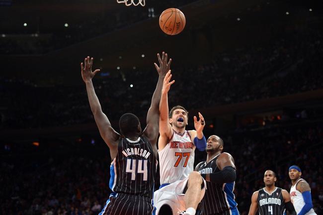 Dec 6, 2013; New York, NY, USA; New York Knicks power forward Andrea Bargnani (77) puts up a shot over Orlando Magic power forward Andrew Nicholson (44) during the second half at Madison Square Garden. The Knicks won the game 121-83. Mandatory Credit: Joe Camporeale-USA TODAY Sports