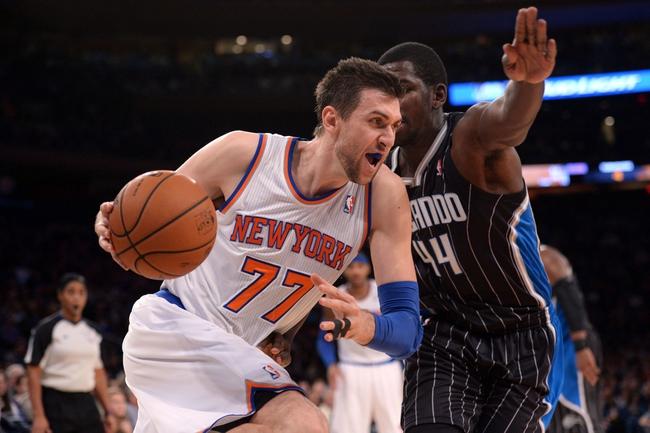 Dec 6, 2013; New York, NY, USA; New York Knicks power forward Andrea Bargnani (77) dribbles by Orlando Magic power forward Andrew Nicholson (44) during the second half at Madison Square Garden. The Knicks won the game 121-83. Mandatory Credit: Joe Camporeale-USA TODAY Sports