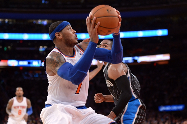 Dec 6, 2013; New York, NY, USA; New York Knicks small forward Carmelo Anthony (7) puts up a shot against the Orlando Magic during the second half at Madison Square Garden. The Knicks won the game 121-83. Mandatory Credit: Joe Camporeale-USA TODAY Sports