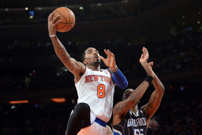 Dec 6, 2013; New York, NY, USA; New York Knicks shooting guard J.R. Smith (8) goes up for a layup against the Orlando Magic during the second half at Madison Square Garden. The Knicks won the game 121-83. Mandatory Credit: Joe Camporeale-USA TODAY Sports