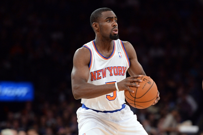 Dec 6, 2013; New York, NY, USA; New York Knicks shooting guard Tim Hardaway Jr. (5) controls the ball against the Orlando Magic during the second half at Madison Square Garden. The Knicks won the game 121-83. Mandatory Credit: Joe Camporeale-USA TODAY Sports