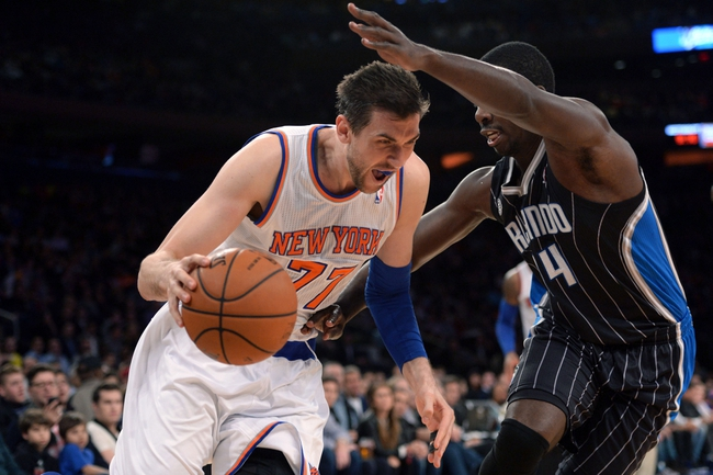 Dec 6, 2013; New York, NY, USA; Orlando Magic point guard Jameer Nelson (14) guards New York Knicks power forward Andrea Bargnani (77) during the second half at Madison Square Garden. The Knicks won the game 121-83. Mandatory Credit: Joe Camporeale-USA TODAY Sports