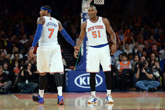 Dec 6, 2013; New York, NY, USA; New York Knicks small forward Carmelo Anthony (7) and small forward Metta World Peace (51) celebrate against the Orlando Magic during the second half at Madison Square Garden. The Knicks won the game 121-83. Mandatory Credit: Joe Camporeale-USA TODAY Sports