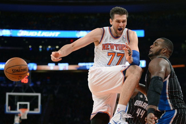 Dec 6, 2013; New York, NY, USA; New York Knicks power forward Andrea Bargnani (77) loses control of the ball against the Orlando Magic during the second half at Madison Square Garden. The Knicks won the game 121-83. Mandatory Credit: Joe Camporeale-USA TODAY Sports