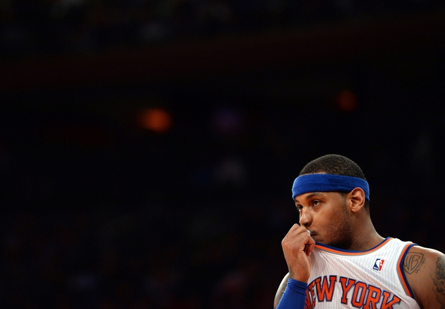 Dec 6, 2013; New York, NY, USA; New York Knicks small forward Carmelo Anthony (7) looks on against the Orlando Magic during the second half at Madison Square Garden. The Knicks won the game 121-83. Mandatory Credit: Joe Camporeale-USA TODAY Sports