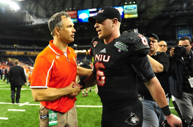 Dec 6, 2013; Detroit, MI, USA; Bowling Green Falcons head coach Dave Clawson shakes hands with Northern Illinois Huskies quarterback Jordan Lynch (6) after defeating Northern Illinois Huskies 47-17 to win the MAC Championship at Ford Field. Mandatory Credit: Andrew Weber-USA TODAY Sports