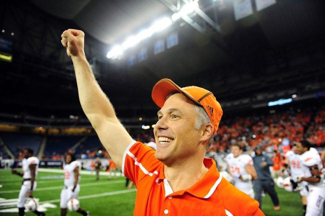 Dec 6, 2013; Detroit, MI, USA; Bowling Green Falcons head coach Dave Clawson celebrates after defeating Northern Illinois Huskies 47-17 to win the MAC Championship at Ford Field. Mandatory Credit: Andrew Weber-USA TODAY Sports